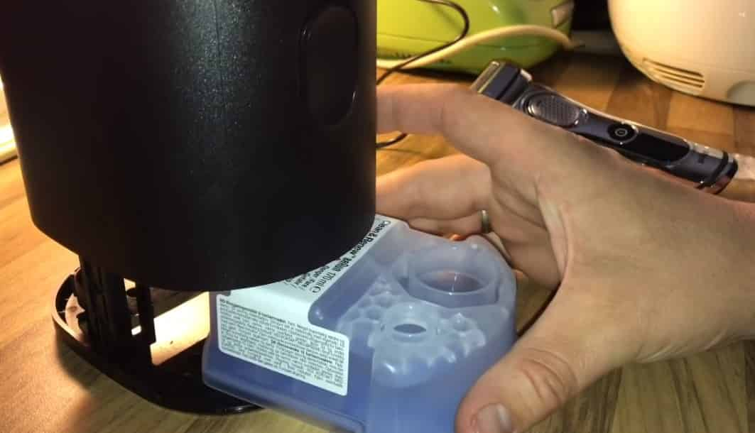 How to insert the cleaning cartridge into cleaning dock